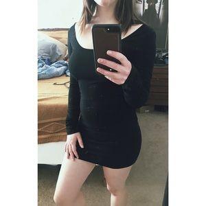 Long sleeve black body con dress